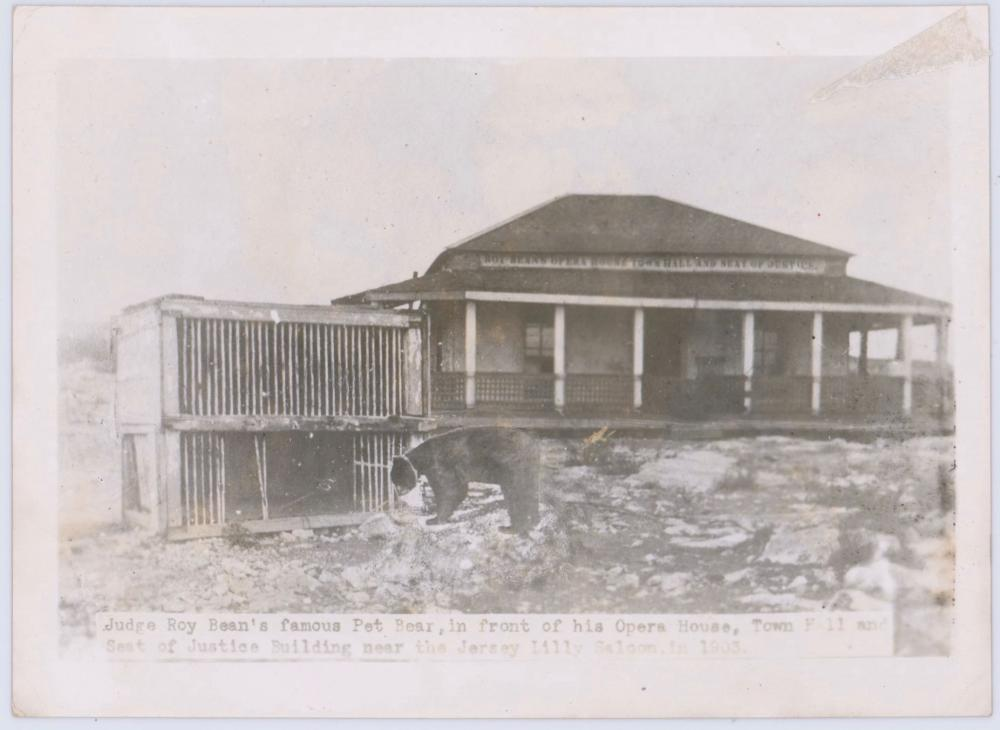 """Unique Vintage Photo of Judge Roy Bean's Famous Pet Bear """"Bruno"""" in front of his Opera House Town Hall and Seat of Justice Building."""