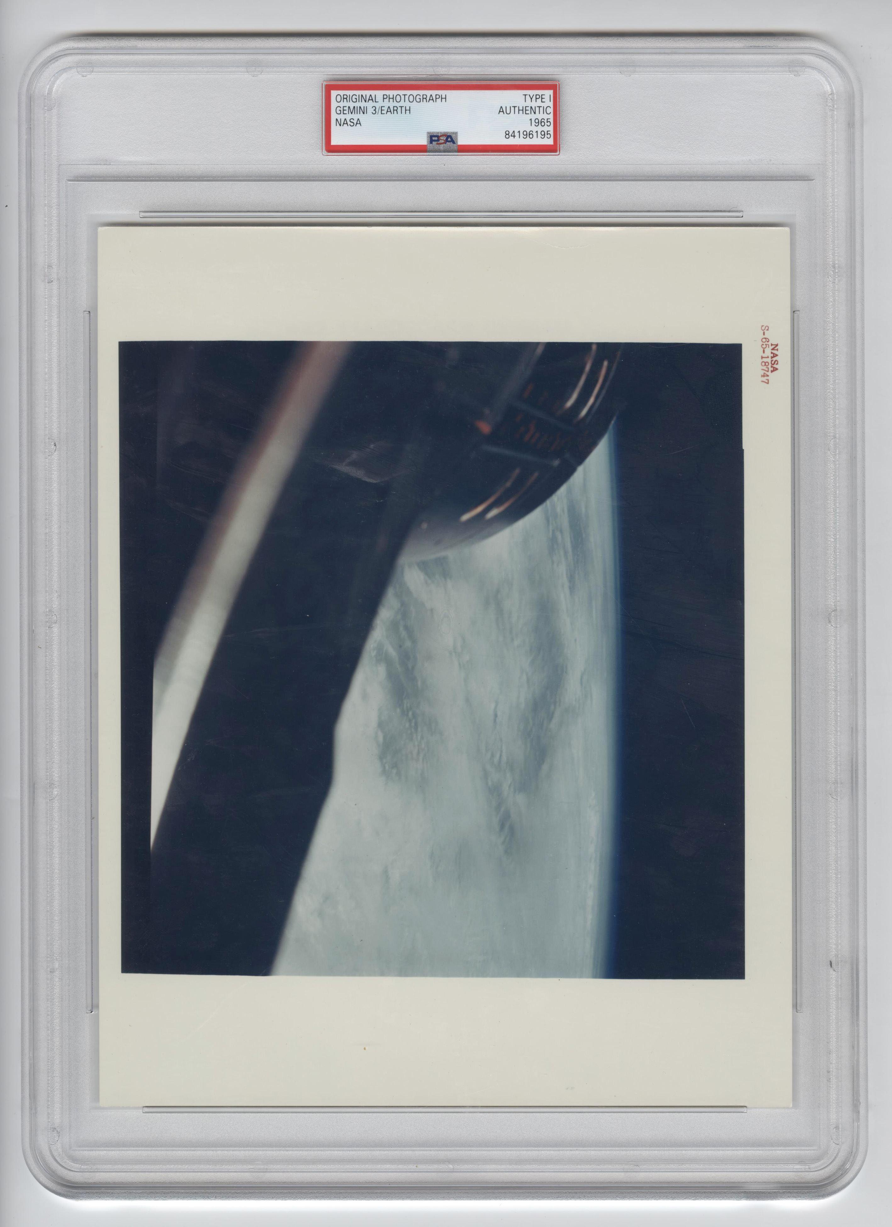 Official NASA Red Number Photo of Gemini-Titan 3, Earth-Sky View Taken by John Young. PSA Slabbed Authentic Type I