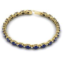 Lot 6152: 30.8 ctw Sapphire & VS/SI Diamond Eternity Bracelet 10K Yellow Gold - REF-245Y5X - SKU:29462