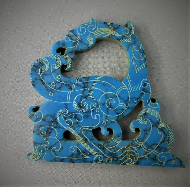 A Chinese archaic turquoise carved dragon-formed pendant
