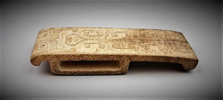 A Chinese archaic carved jade sword decor