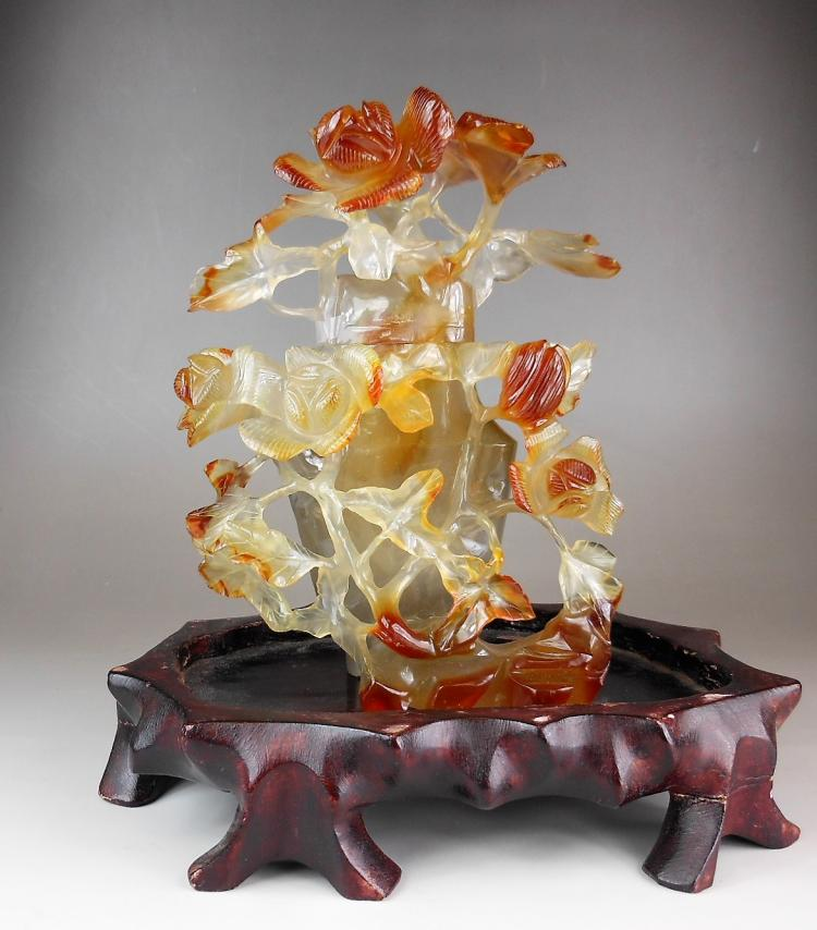A Chinese agate carved flowers vase
