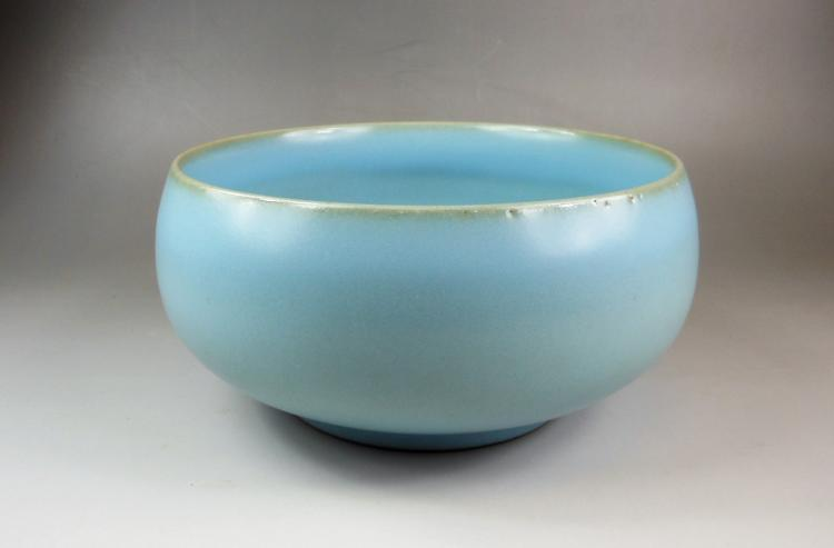 A Chinese Qing dynasty blue glazed porcelain brush waster