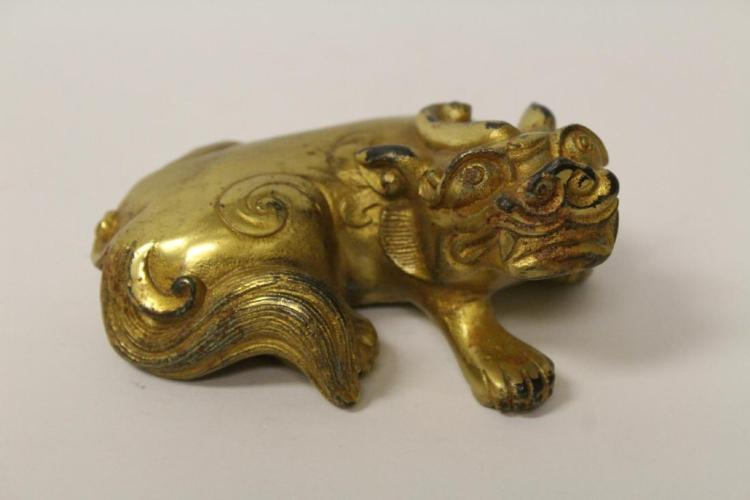 A Chinese Han dynasty gilt bronze qilin