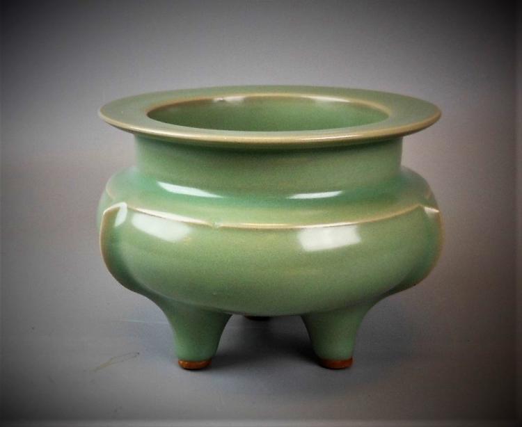 A Chinese Ming dynasty Longquan-yao celadon porcelain tripod censer
