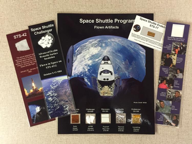 Flown shuttle presentation with 5-orbiter pieces from each shuttle