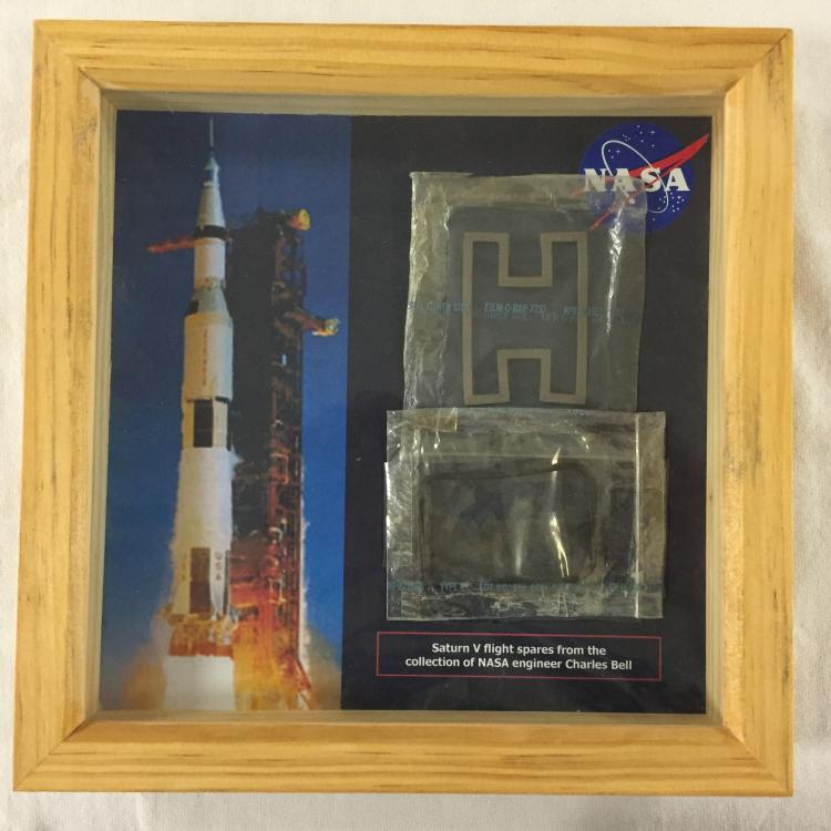 Framed display of 2 Apollo/Saturn V flight spares