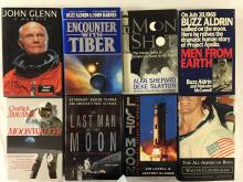 Hard-bound first edition print books signed by their astronaut authors