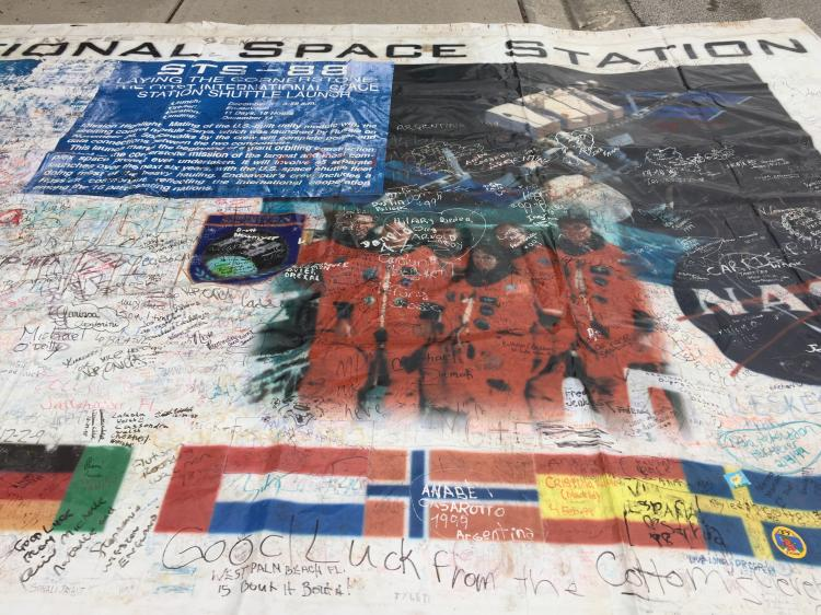 Huge Banner Honoring STS-88/1st ISS with thousands of signatures