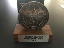 Goddard Development team award with stand