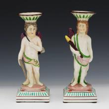 English Pearlware Pair of Putti Figural Candlesticks, Attributed to Neale & Co., Circa 1800