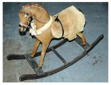 Early wooden rocking horse, covered in real