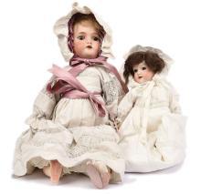 PAIR inc Pair of bisque dolls: (1) Schoenau