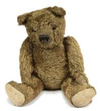 Early dark brown mohair Teddy Bear, clear glass