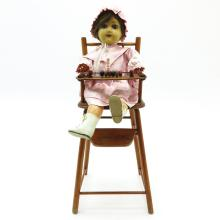 VINTAGE DOLL IN HIGH CHAIR