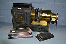 Antique brass and metal magic lantern and slides,