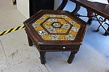 Tile topped hexagonal table, standing turned legs