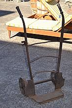 Antique iron coal bag trolley along with a cast
