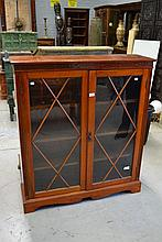 Walnut bookcase, approx 122cm H x 107cm L x 30cm D