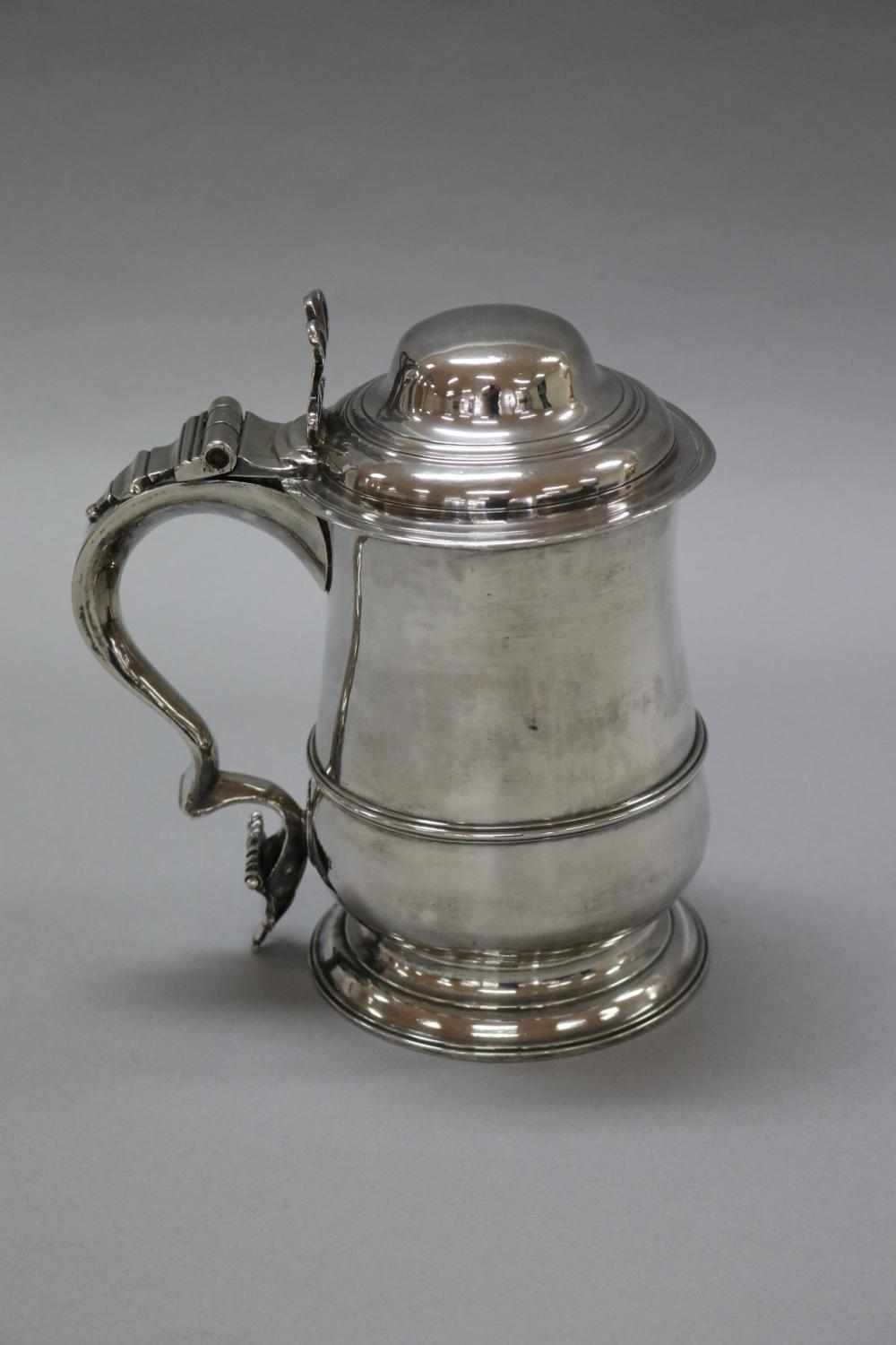Antique 18th Century George III hallmarked sterling silver tankard of plain baluster form with plain spread foot, domed top & open work thumb piece, London, 1770, mark of John King, marked to base & under lid, approx 20cm H & 900 grams