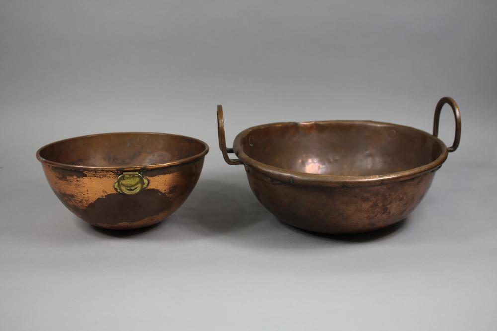 Two antique French copper bowls, one with handles, approx 13cm H x 35cm Dia and smaller (2)