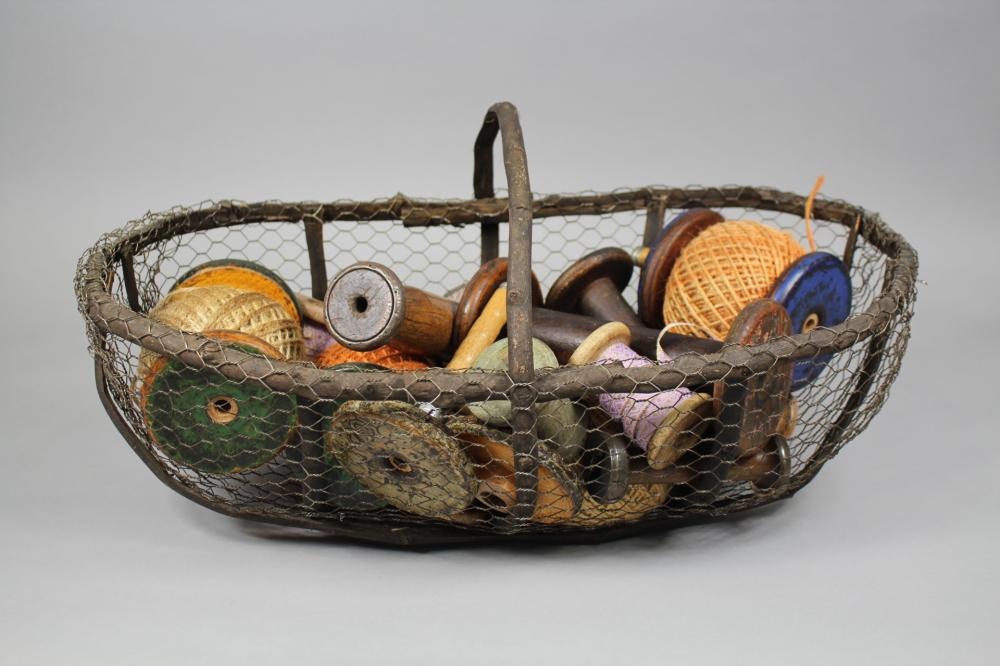 Antique bent stick  and wire basket along with antique and later spools of cotton, basket approx 55cm W