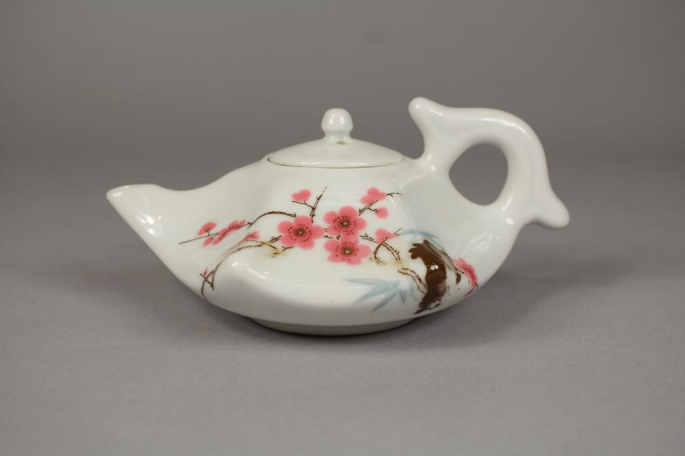 Chinese 20th century porcelain shaped teapot, approx 7cm H x 15cm W