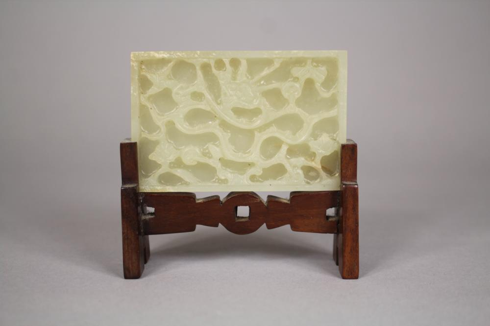Chinese Jade carved panel on wooden stand, approx 8cm H x 8.5cm W