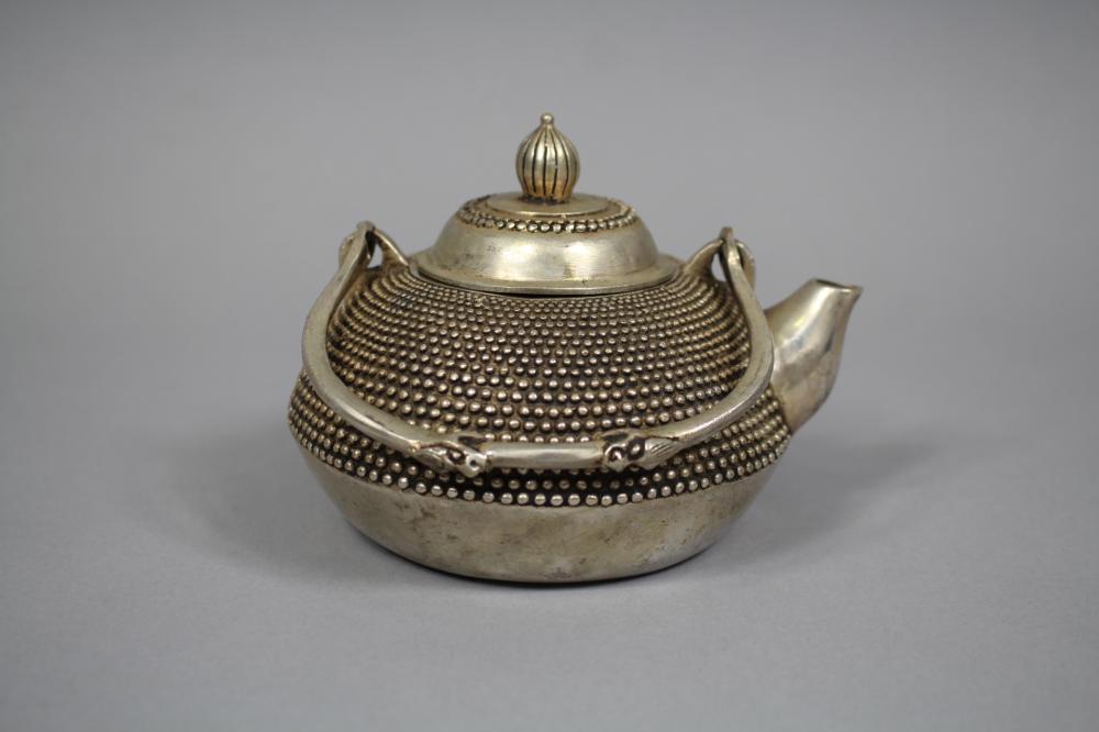 Chinese white metal teapot, approx 10cm H x 14cm W
