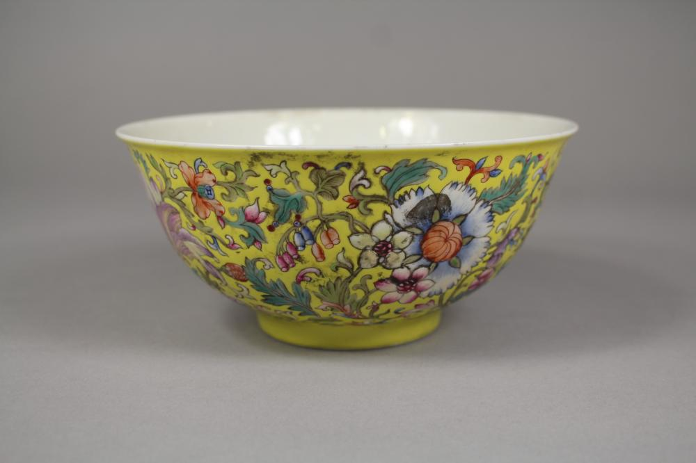 Chinese Qing Dynasty Qianlong marked porcelain bowl, of yellow ground, bats painted to centre, floral decoration, AF, approx 7.5cm H x 16cm Dia