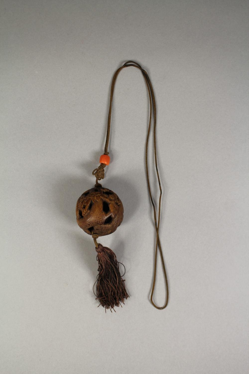 Chinese carved eaglewood ball form Dragon necklace / pendant