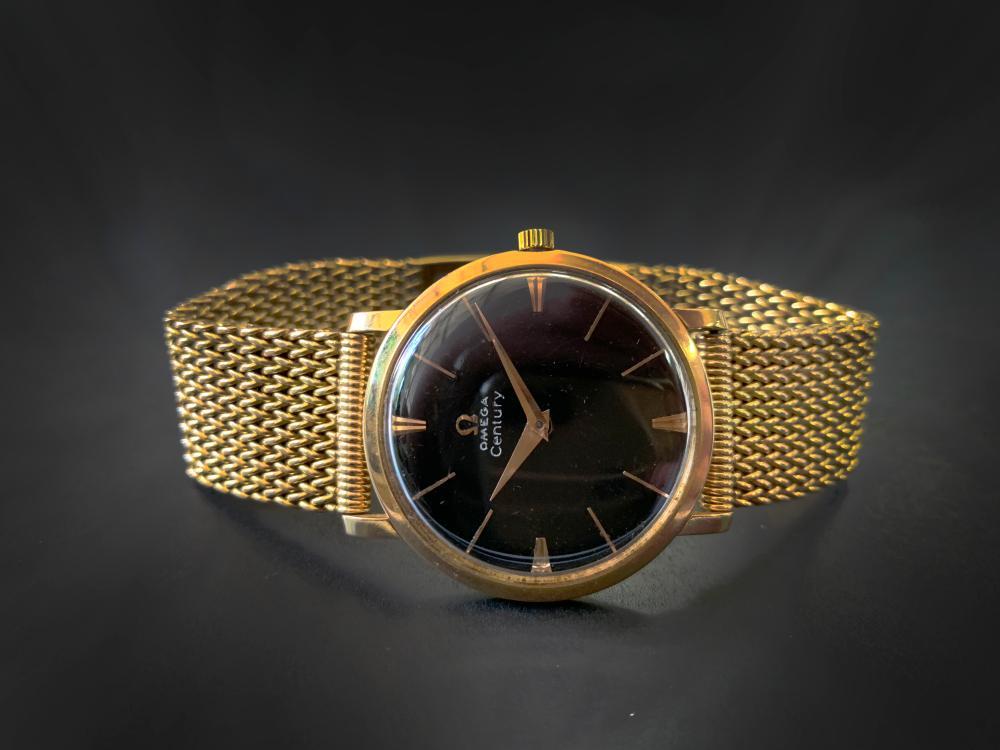 Vintage men's Omega Century wrist watch with 18k gold mesh bracelet