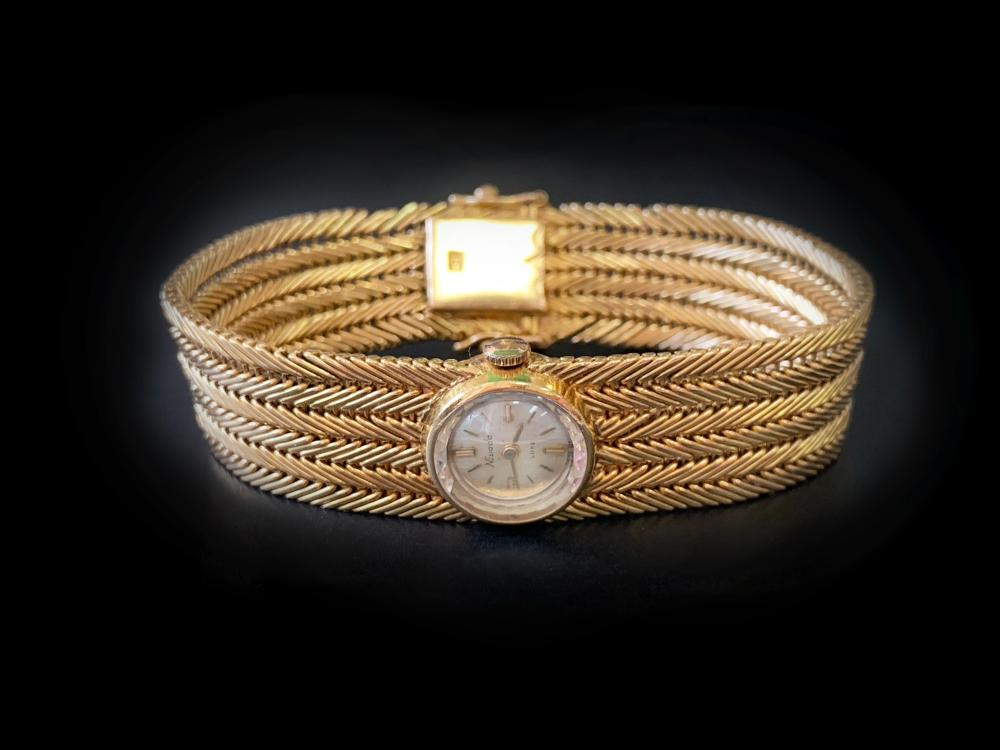 Nivada ladies watch with 18k gold mesh bracelet, approx total weight 55 grams