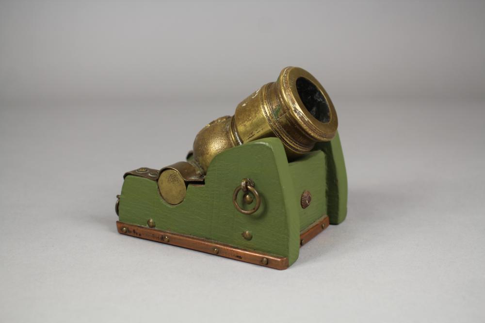 Miniature bronze mortar in wooden frame, brass & copper hardware, approx 9cm H x 11cm W