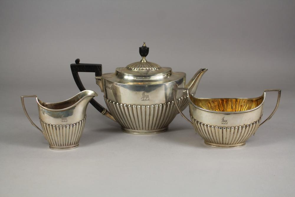 Antique Victorian hallmarked sterling silver three piece tea set, half fluted body work, also an ebonized urn form finial to the teapot, by William Hutton & Sons, Edward Hutton, London, 1884 - 1886, approx total weight 845 grams