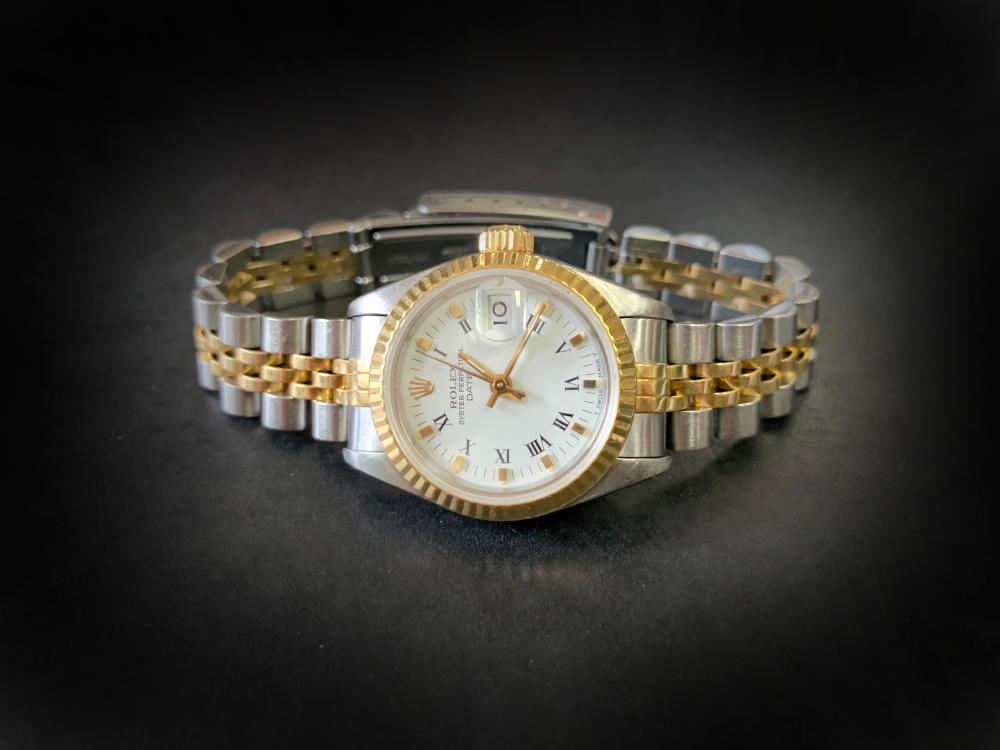 Ladies automatic Rolex Oyster Perpetual date wrist watch, white enamel face with roman numerals, with a stainless steel and 18ct gold jubilee bracelet, no 9757123 with box and paper work, bracelet replaced 1999