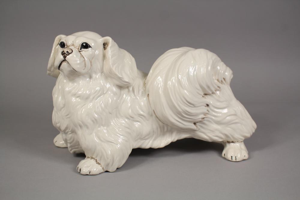 Italian glazed porcelain figure of a Pekingese dog. Signed at base. Approx 20cm H