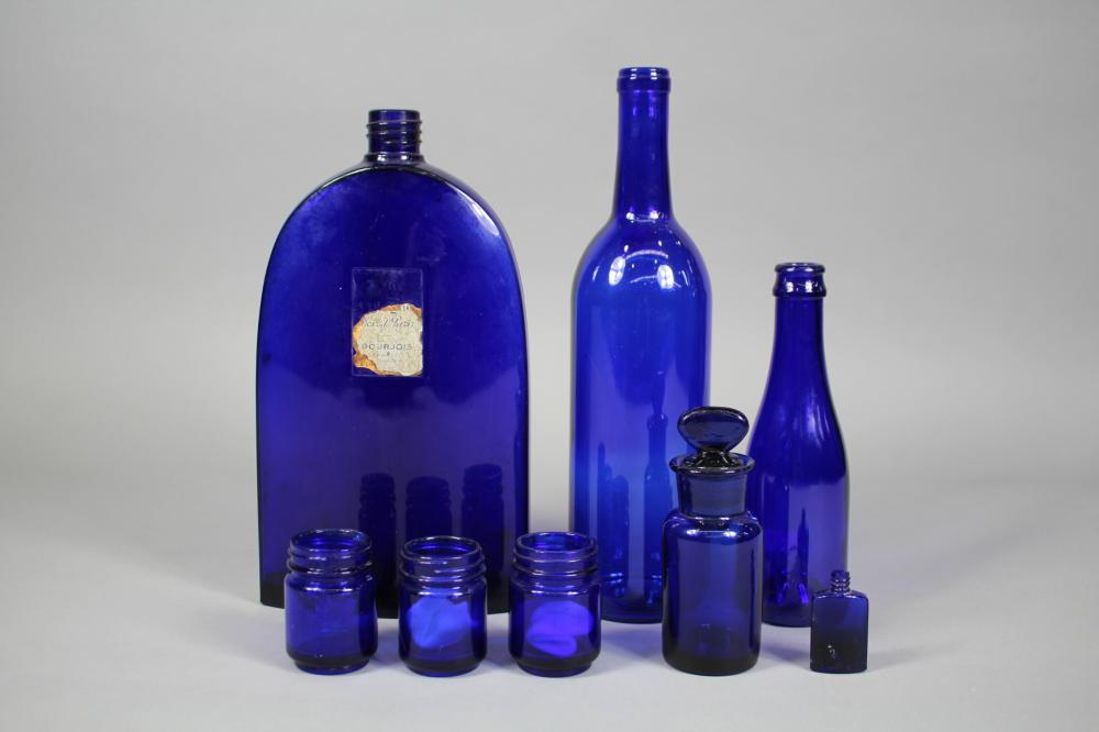Lot of blue bottles, approx 29cm H and shorter
