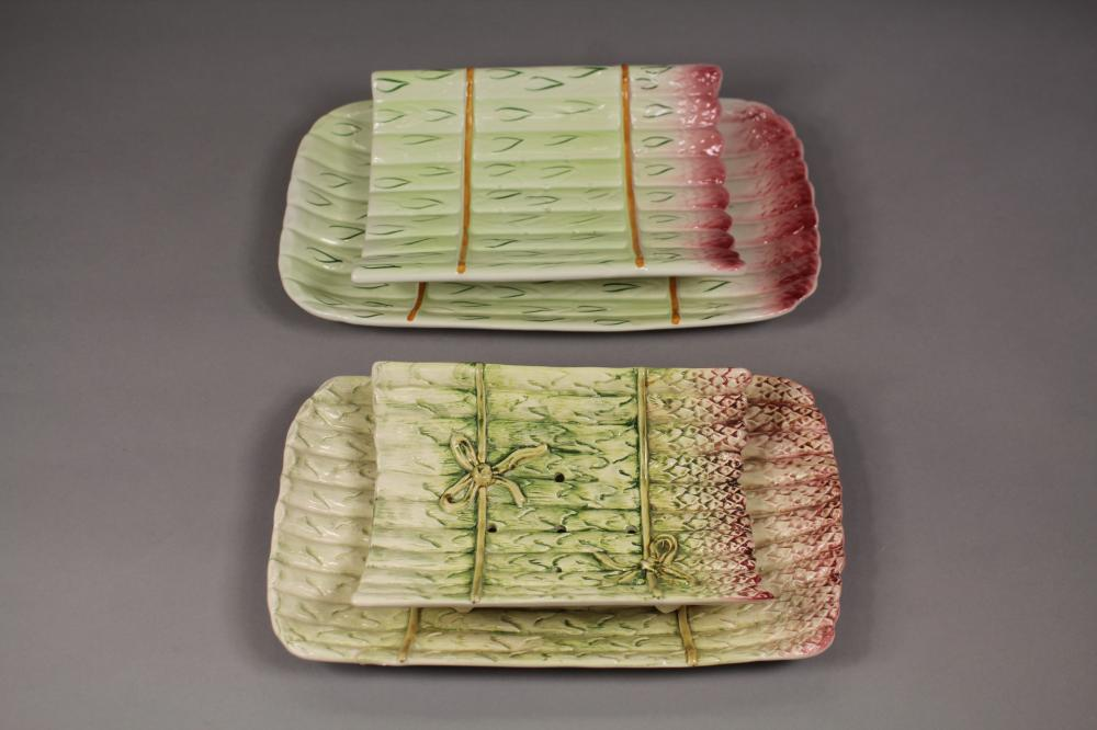 Two asparagus cradles with dishes, AF to one dish, approx 33cm W and smaller (2)