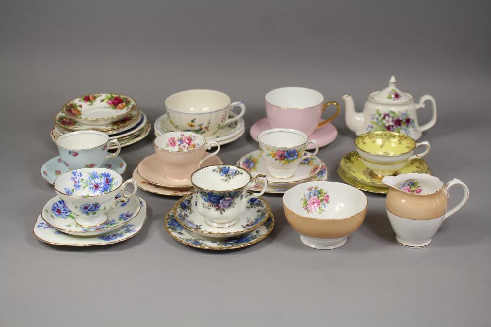 Assortment of tea cups, saucers, plates, teapot, milk jug, sugar bowl to include Aynsley, Royal Albert, etc