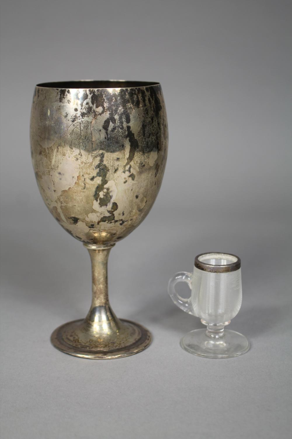Antique silver goblet market TN 0900 together with a miniature cup with hallmarked sterling silver rim, approx 16cm H and shorter (2)