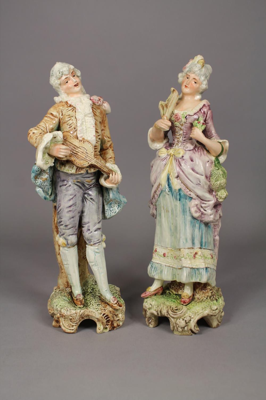 Pair of antique Continental porcelain male & female figures, each approx 30cm H (2)