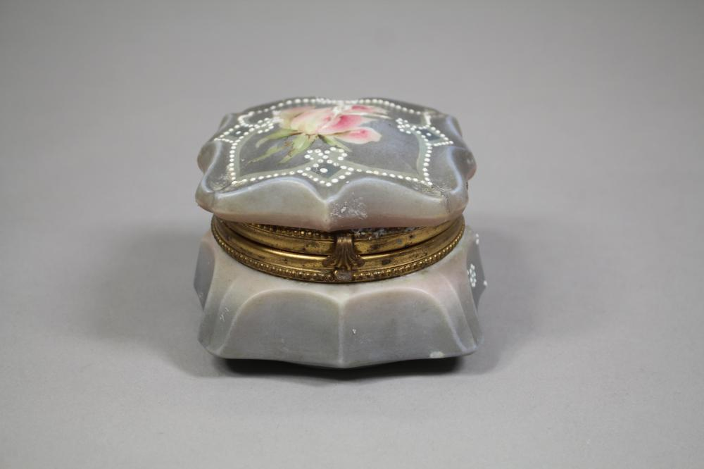 Antique enamelled glass jewel box with gilt metal clasp marked Nakara,C.F.M CO, approx 8cm H x 11cm W
