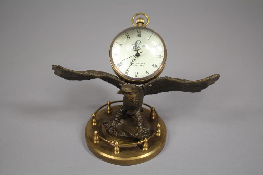 Decorative ball form watch atop eagle, approx 12cm H x 17cm W