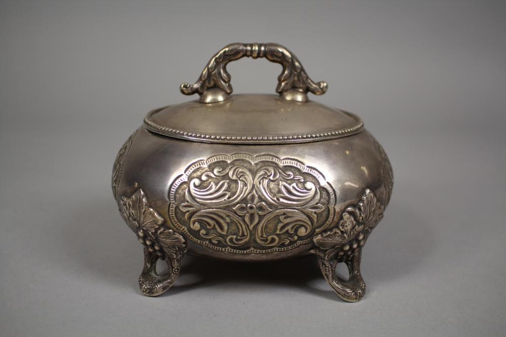 Russian silver sugar casket / box, standing on grape vine feet, of oval form, Assay Master mark of Josef Sosnkowski, marked O.C 1883 Warsaw, stamped OSTOCCHUISKI?, approx 12.5cm H x 15cm W x 13cm D & 445 grams