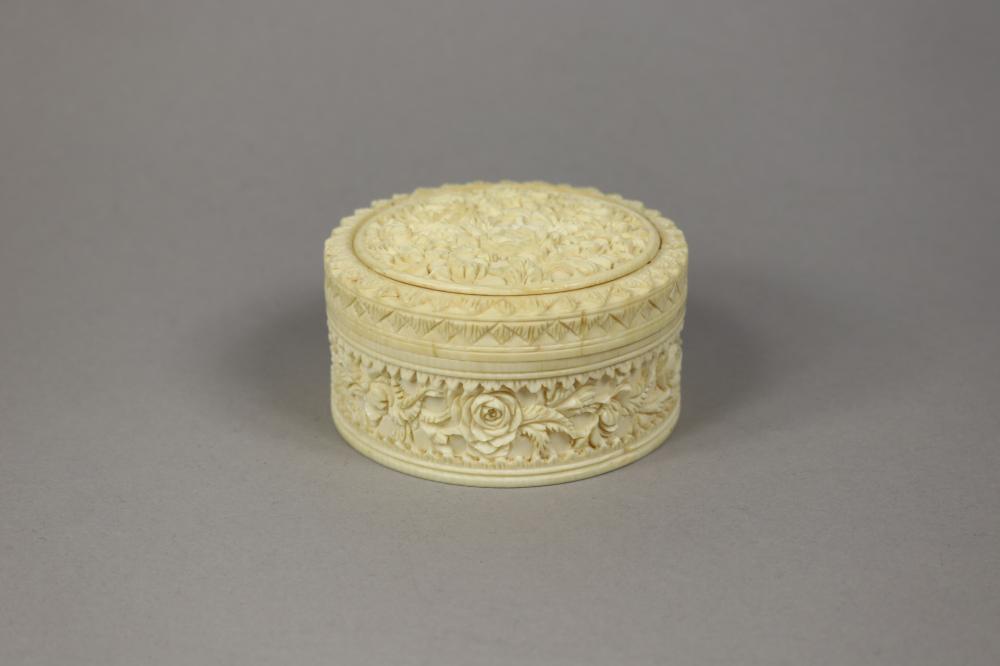 Carved ivory circular  trinket box, approx 4.5cm H x 9cm Dia