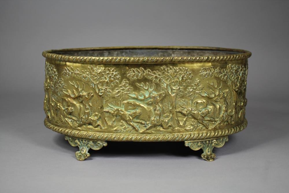 Antique French oval form brass jardiniere, embossed with a full band of hunting scenes, all standing on four legs, approx 16cm H x 34cm W x 22cm D