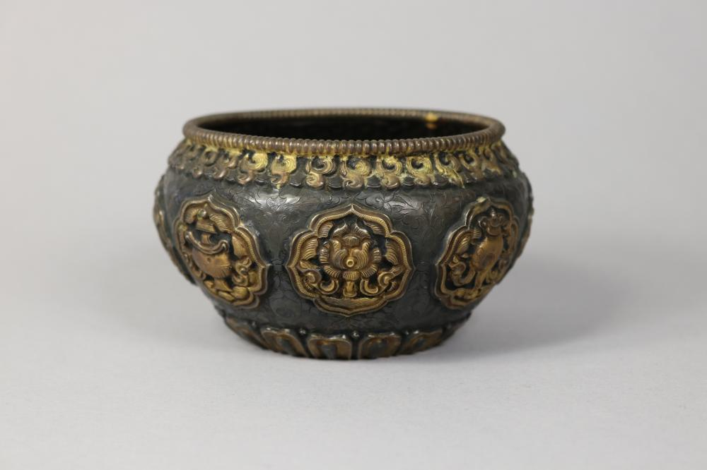 Antique Chinese 19th Century Silver pot, nicely decorated with symbols in bosses, approx 7cm H x 11cm W