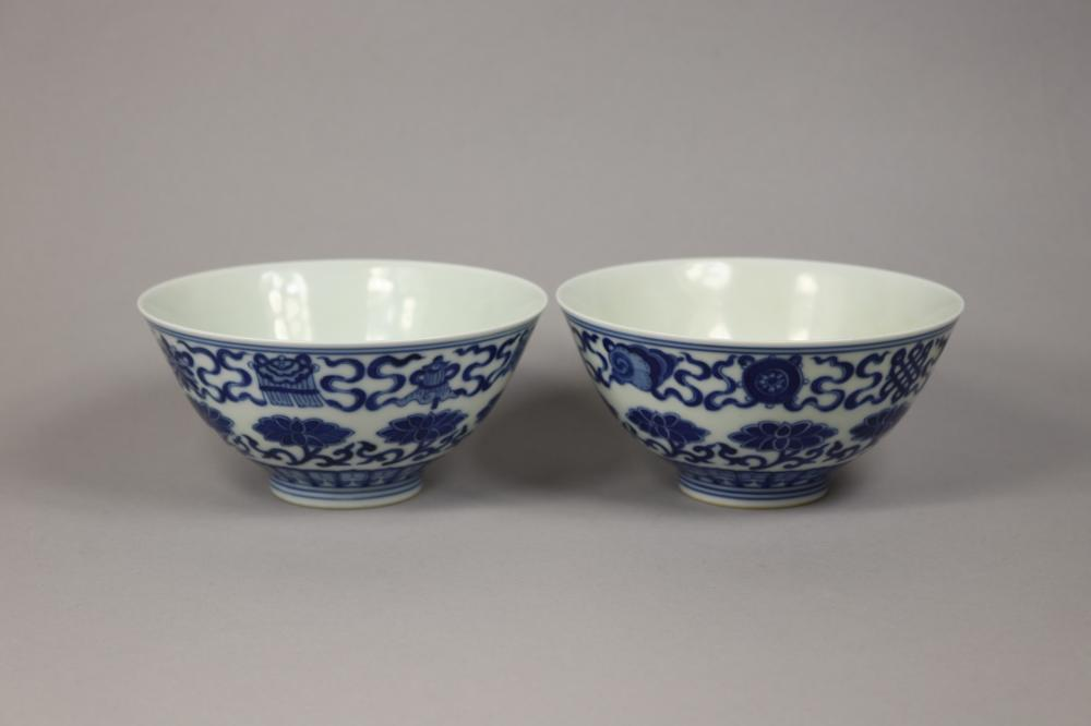 Pair of Chinese blue & white bowls, nicely decorated with fish & flowers, six character reign marks to base, each approx 6.5cm H x 13.5cm Dia (2)