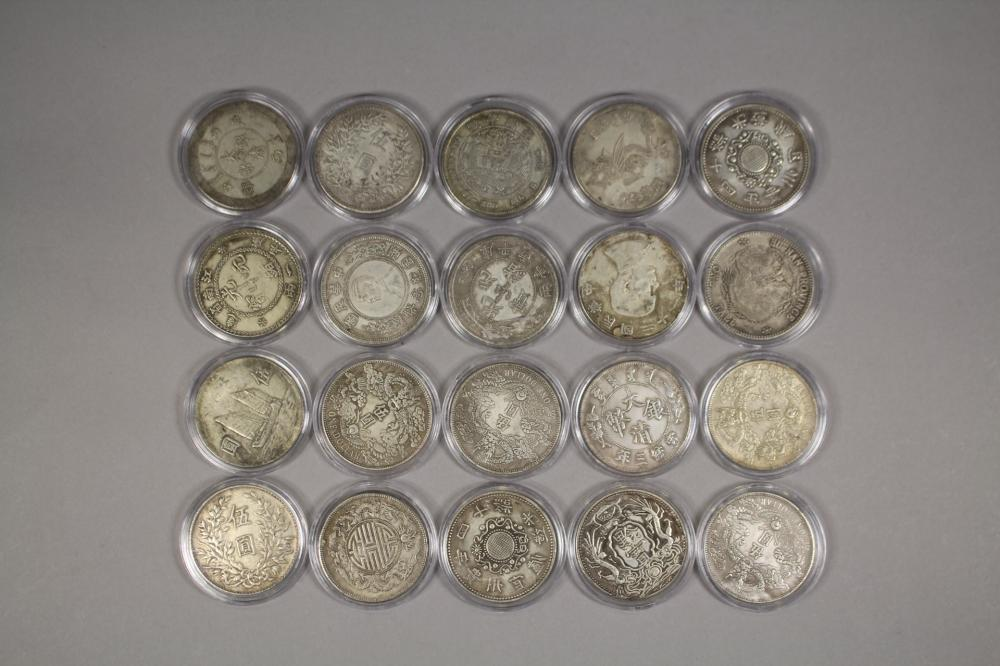 Twenty large Chinese coins in white metal (20)